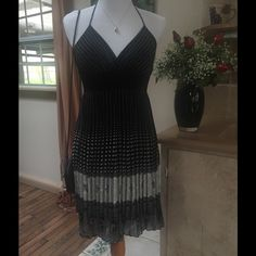 Halter Dress ❤️❤️❤️ Chiffon black and white halter dress. Pleated skirt which is just above the knees in the front and longer n the back.  Dress is very slimming and comfortable. Only worn once! Wink Dresses Asymmetrical