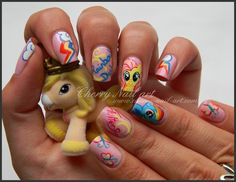 nail art my little pony  I love these nails, but that thing she's holding is not a my little pony.