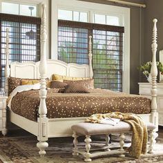 Wood four-poster bed with a scalloped panel headboard and turned posts.  Product: BedConstruction Material: Wood...