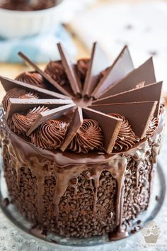 Positioning the chocolate blades over the cake - part of My Evil Twin's Kitchen's Wicked Windmill Chocolate Cake step-by-step instructions