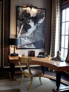 Jean Louis Denoit does home office in a fantastically French way using a curved desk to take advantage of a room with a view. Lighting the spectacular painting will not only bring the eye to the painting, but will also provide additional ambient lighting. #VTHome