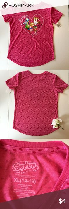 Pink Shopkins Tee Shirt w/ Hearts NWT! Adorable girl's Tee Shirt with Shopkins on the front!  Detailed with hearts. Size is an XL with a suggested 14-16 sizing.  BRAND NEW WITH TAGS!  Materials: 65% polyester 35% rayon Shopkins Shirts & Tops Tees - Short Sleeve