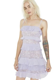 For Love & Lemons Lilac Cosmic Tiered Lace Dress the mysteries of the universe ain't got nothin' on you, babe…They'll put ya in the astronomy books for this dress featurin' a filmy lace construction, pale purple lace and star-embroidered tulle panels, tiered smooth georgette ruffles, full lining, square neckline, tailored mini fit, adjustable shoulder straps and invisible back zipper closure.