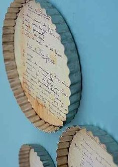 Family recipes on old baking tins hung in the kitchen