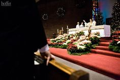 One of the biggest perks of being a Christmas bride is that if you're getting married in a church, it will already be decked out in all its splendor, so you don't have to order as many flowers and other décor.