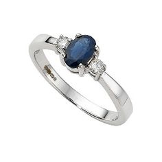 Blue Saphire White Gold Engagement Ring simple yet classy...  :). Love it love it <3
