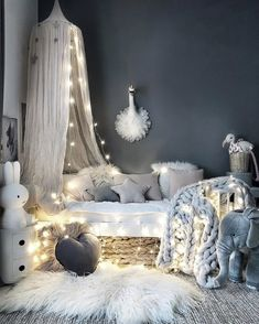 What a beautiful, cosy kid's room! Star and heart shaped cushions are available online.