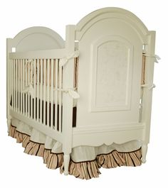 The Celine Crib is a wonderful choice for your little girl's nursery. The Celine Crib features hand-turned feet, scalloped bottom and vintage caning. We make our cribs to adhere to the highest safety standards.  Your Celine Crib will shine with an accent color! Choose from over 30 different colors and stains to customize your piece to your unique personality. Minnie Driver loved her Celine Crib! Newport Cottages