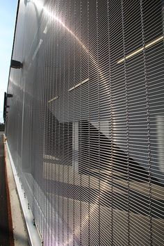 Architectural mesh with good rigidty and high open area. Widely used in façade design as well as interior applications. Facade Design, House Design, Parking Building, Metal Net, Shanghai, Facade Lighting, Grill Design, Wire Mesh, Facade Architecture