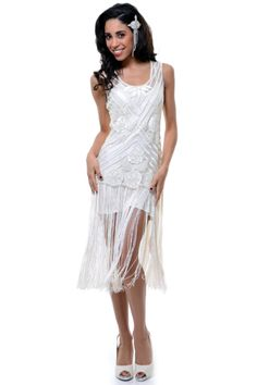 An amazing reproduction flapper dress that is all hand beaded with gorgeous glass beads. The bodice is a striped design with beaded roses throughout. There are thick tank style straps and a dropped waist. The dress is finished off with a long fringe skirt.