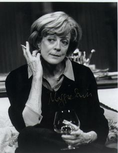 Maggie Smith smoking a cigarette (or weed)