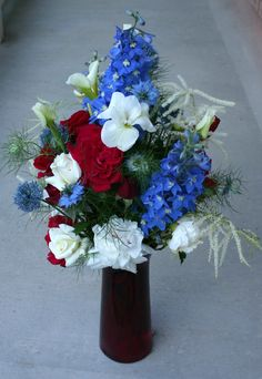 Roses, carnations, white flower unknown, delphinium