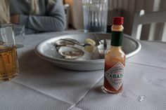 Plump, juicy oysters, seasoned with Tabasco in Whitstable