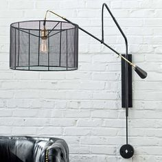 Graydon's Desk or by Bed:  Extremely Cool! Shade is metal 49H overall and 65 Deep overall:  Boom Sconce