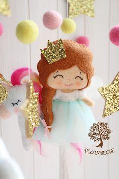Купить или заказать Детский мобиль из фетра для детской кроватки 'Принцесса и единорожка' в интернет-магазине на Ярмарке Мастеров. В сказочной и доброй стране под названием Расчудесье живут самые сказочные герои. Вы скажете: 'Принцесса есть у всех!' А вот принцесса с чудной единорожкой - только у нас =) Яркий и при этом очень нежный мобиль сделает сказочной любую детскую кроватку. Идеальный подарок для маленькой крохи! Игрушки для детского мобиля в кроватку 'Принцесса... Felt Crafts Diy, Felt Diy, Christmas Ornament Crafts, Felt Ornaments, Mobiles, Felt Decorations, Kids Boutique, Felt Patterns, Toy Craft