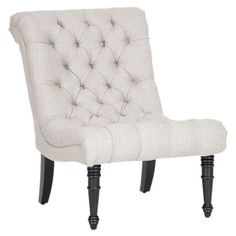 Linen-upholstered accent chair with button-tufting and birch wood frame.Product: Chair Construction Material: Lin...