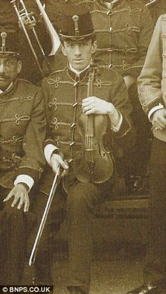 Wallace Hartley with his violin.  God bless him.  What class - especially by today's crass and coarse standards.