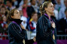 Gold medallists Misty May-Treanor (L) and Kerri Walsh Jennings of the United States celebrate winning the Gold medal during the medal ceremony for the Women's Beach Volleyball on Day 12 of the London 2012 Olympic Games at the Horse Guard's Parade on August 8, 2012 in London, England.