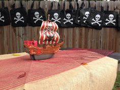 Toddler Birthday Party - Pirate Birthday Party – pirate party decoration, red and black party decoration, skull bags, pirate loot bags, A Little This, A Little That trendy boutique items including chevron print luggage and chevron print duffle bags.