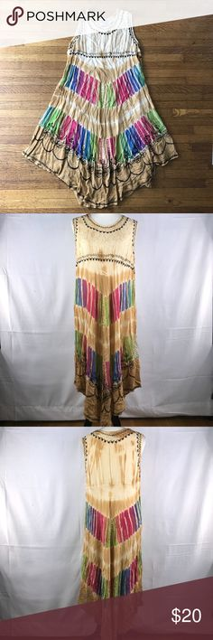 """Bohemian hippie dress for festivals -just cruising Total bohemian. Total free spirit. Perfect for festivals, beaches, vacation, or when the free spirit calls.   By Just Cruising, this is a """"free size"""" dress featuring embroidery and tie dye.   No flaws noted.   See photographs for measurements. My mannequin is a standard size 4 for additional reference.   —-   I do have a dog who sheds. I lint roll prior to shipping, but it is good to be aware Just Cruising Dresses Asymmetrical"""