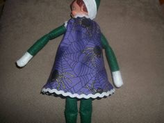 This dress is purple with black spiders on it The dress will fit dolls with a five inch waist The doll is not included Thank you for looking Please email me with any questions Christmas Elf Doll, Purple Dress, Baby Car Seats, Dolls, Dresses, Purple Sundress, Vestidos, Lilac Dress, Doll