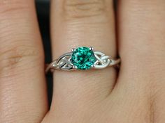 http://rubies.work/1032-ruby-rings/ Cassidy 14kt White Gold Round Emerald Celtic Knot by RosadosBox Freakin' gorgeous!