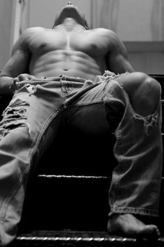 This makes me think of Christian Gray when he wears the ripped jeans before entering The Red Room.