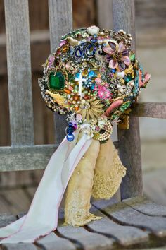 this is the epitome of what I want to bouquet to be like..so special with all vintage jewelry from grandma and mom, she keeps all broken jewerly