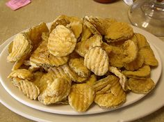 "Fried Pickles, recipe from the ""Cock of the Walk"" restaruant.  love...  1/2 c  bisquick   8 Tbsp  corn meal   3 Tbsp  pickle juice    hamburger dills"