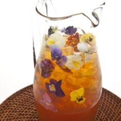 The Leblon Ice Tea is a festive, refreshing blend of tea and rum blended with edible flowers - just perfect for spring.