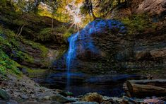 Download wallpapers waterfall, rock, forest, sun rays, spring, water, mountain waterfall