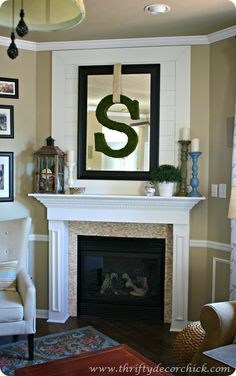 I love this wood wall treatment from Thrifty Decor Chick. I don't have a mantle but I do have a big flatscreen that this might look nice with.