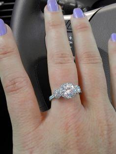 Three-stone engagement ring with 1.01 carat center diamond.