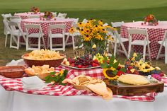 Red and white checked tablecloths for outdoor party.