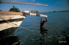 An Ibo boy hands onto the bowsprit of a dhow. #WhoeverFearstheSea