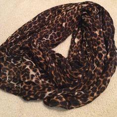Express cheetah print scarf (NWOT) Infinity scarf from express. Cheetah print. Express Accessories Scarves & Wraps