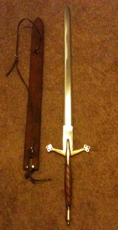 Scottish Claymore sword. 3 feet 8 inches. Claymores are very long swords. Longer than most swords..