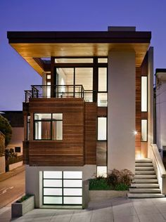 I always bounce between traditional home styles (what we have now) and modern. Perhaps this will be my next home. :)