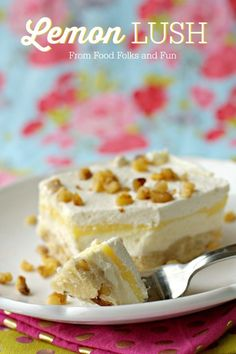Lemon Lush layered dessert cake with a shortbread crust, sweetened cream cheese, lemon pudding and whipped cream