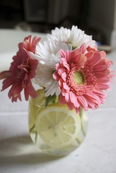 How sweet this would look on dining table. Mason Jar decoration - love the lemon idea.