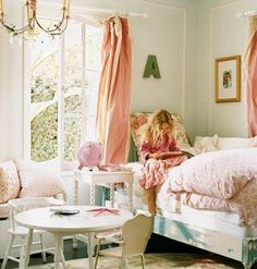 the painted bed effect, the curtains...the fluffy bedding at the end...everything