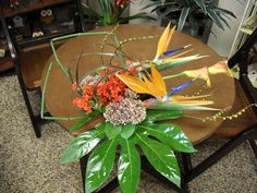 orange and green flower arrangement for wedding and events.