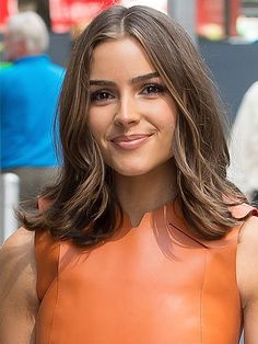 Medium-Length Hairstyles - Olivia Culpo's Piece-y Blowout | allure.com