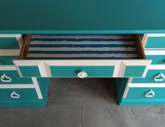 "Turquoise vanity-style desk, freshly hand painted in Sherwin-Williams ""Turquish"" chalk paint recipe with ""Greek Villa"" white accents and coordinating striped drawer liner. Dovetailed drawers all slide smoothly. Sealed in clear wax for protection and buffed to a subtle luster. 30"" h x 48"" w x 20"" d. June 2015. To see/purchase more of my work, visit (and ""like!"") my FB page: www.facebook.com/schoolhousepop"