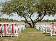 Decorate the back row of ceremony chairs to dress up the white plastic