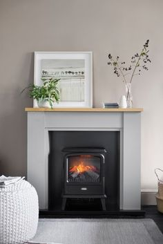 Buy Malvern Fireplace Surround from the Next UK online shop – Fireplace tile ideas Electric Fireplace Surround, Electric Fireplace Suites, Wooden Fireplace Surround, Grey Fireplace, Living Room With Fireplace, Fireplace Surrounds, Fireplace Design, Living Room Grey, Home Living Room