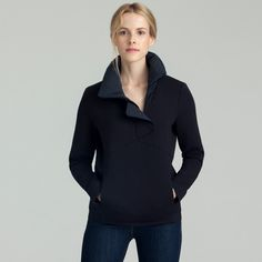 """The System Pullover is a stylish take on a traditional sweatshirt made of an extra-soft and luxe double knit. It features an oversize down-filled collar made of stretch woven fabric and features a half-zip covered by an asymmetrical placket and magnetic closure. There are also zippered hand pockets and an elastic detail at the cuffs and the hem for a clean and flattering aesthetic. Size & fit Fits true to size.In-studio model is 5'8""""and wearing size small. View Size Gu..."""