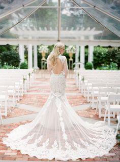 Dramatic lace train and bare back wedding dress: http://www.stylemepretty.com/2016/08/26/classic-elegant-duke-mansion-wedding/ Photography: Almond Leaf Studios - http://almondleafstudios.com/