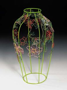 I think this vase is quite artistic because instead of just creating the shape of the vase, they have created flowers to go on the outside. The colors used are nice too.