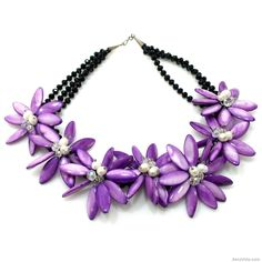 Amazing statement necklace made with natural mother of pearl, freshwater pearls, and crystal.  A lovely purple ensemble that will accent your natural beauty and charm.   ~One of a Kind Purple Lily Mother of Pearl Petals Necklace~ SKU: NS-0154-PUR